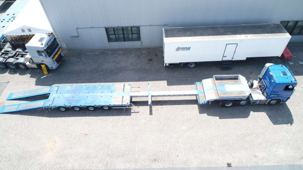 4 AXLE SEMI TRAILER // MULTI PURPOSE USE // 4 AXLES HYDRAULIC STEERING // EXTENDABLE TILL 14,8 M // PAYLOAD 43 T // 2 KINGPIN HEIGHTS 1.250 & 1.150 MM // HYDRAULIC RAMPS