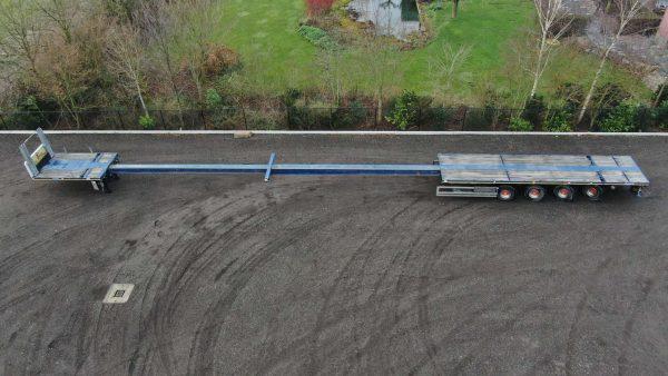 4 Assige vlakke trailer, dubbel uitschuifbaar tot 34,8 m, laadvermogen tot 49 ton